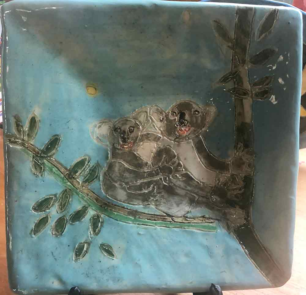 Square Koala Plate ceramic by Zion levy Stewart. Painting on canvas and ceramics from his Paradise Studio Mullumbimby Australia.